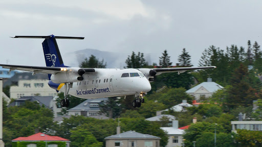 A plane making its final descent after trying to pack for an Iceland trip.