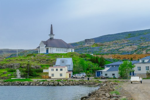 View of the town, fishing port, and the church in Holmavik, the Westfjords region, Iceland.